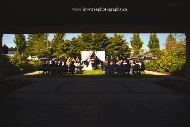 wedding ceremony at Beach Grove Golf Club; image by vancouver wedding photographers www.lovetreephotography.ca