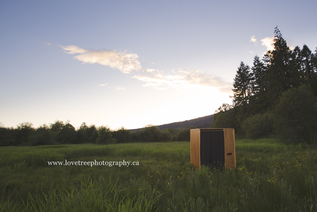 a rustic wooden photobooth rental - the perfect addition to a vintage or shabby chic wedding. image by Vancouver wedding photographers www.lovetreephotography.ca
