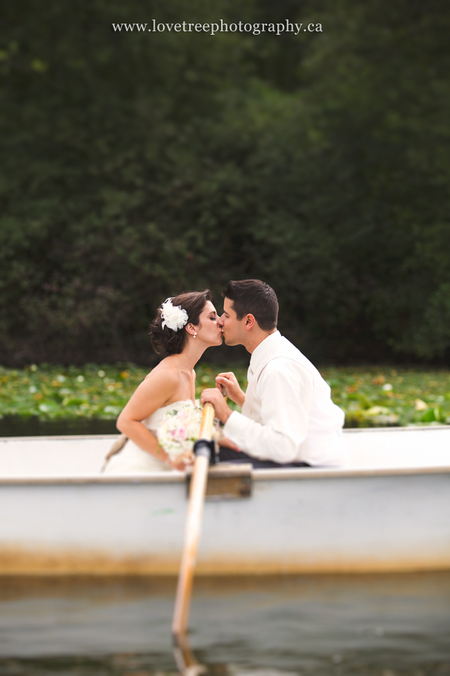 bride and groom in a rowboat by love tree photography